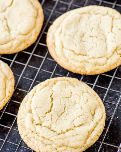 Soft and Chewy Sugar Cookies! The perfect soft and chewy sugar cookies - a little moist and just a tiny bit chewy with a buttery vanilla taste. | HomemadeHooplah.com