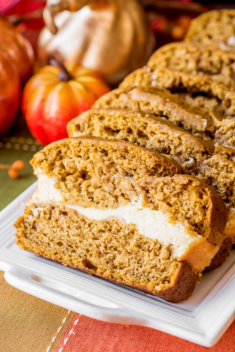 Cream Cheese Pumpkin Bread! This no-fuss recipe makes an amazingly soft and spongy pumpkin bread with a sweet swirl of cream cheese in the middle. Perfect for fall! | HomemadeHooplah.com