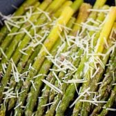 10 Minute Parmesan Asparagus! Need a super easy (and healthy!) side dish for dinner? This parmesan asparagus is perfect! Tender asparagus with hints of garlic and shredded parmesan. | HomemadeHooplah.com