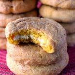 Pumpkin Cheesecake Snickerdoodles! Deliciously soft and puffy pumpkin snickerdoodles with a sweet cream cheese center. | HomemadeHooplah.com