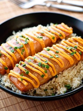 Teriyaki Salmon with Sriracha Cream Sauce! Fresh salmon marinated and baked in a homemade teriyaki sauce and topped with a sriracha cream sauce - make it as sweet or as spicy as you like! | HomemadeHooplah.com
