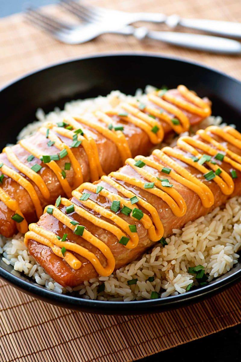 Teriyaki Salmon with Sriracha Cream Sauce! Fresh salmon marinated and baked in a homemade teriyaki sauce and topped with a sriracha cream sauce - make it as sweet or as spicy as you like! | HomemadeHooplah.com