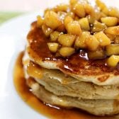 Apple Cinnamon Pancakes! Old fashioned and fluffy cinnamon pancakes topped with fresh cuts of apple cooked in a cinnamon syrup glaze. A perfectly sweet breakfast! | HomemadeHooplah.com