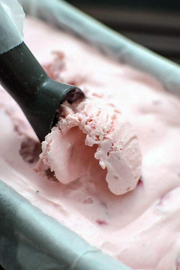No Churn Strawberry Ice Cream! Capture the taste of spring without the extra appliance on your counter. You'd never know this was no churn ice cream! | HomemadeHooplah.com