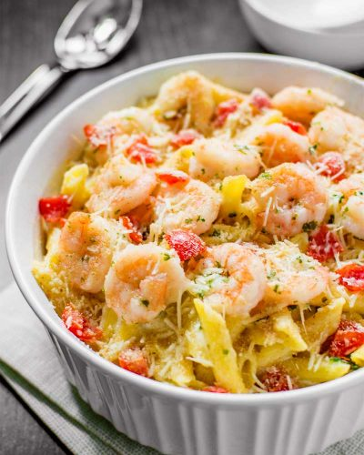 Baked Parmesan Shrimp! Bring the iconic taste of Olive Garden's baked parmesan shrimp to the comfort of your own dinner table with this spot-on copycat shrimp pasta bake recipe. | HomemadeHooplah.com