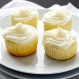 Limoncello Cupcakes with Limoncello Frosting! Dense and cake-like Limoncello cupcakes topped with whipped cream cheese frosting that's infused with even more Limoncello.   HomemadeHooplah.com