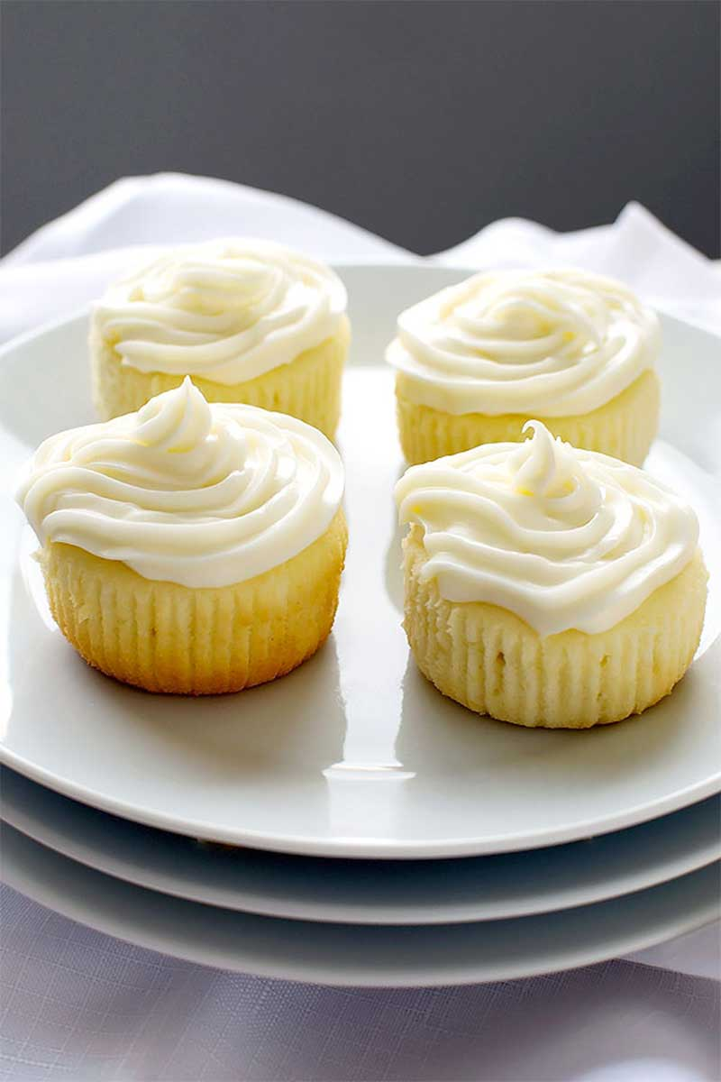 Limoncello Cupcakes with Limoncello Frosting! Dense and cake-like Limoncello cupcakes topped with whipped cream cheese frosting that's infused with even more Limoncello. | HomemadeHooplah.com