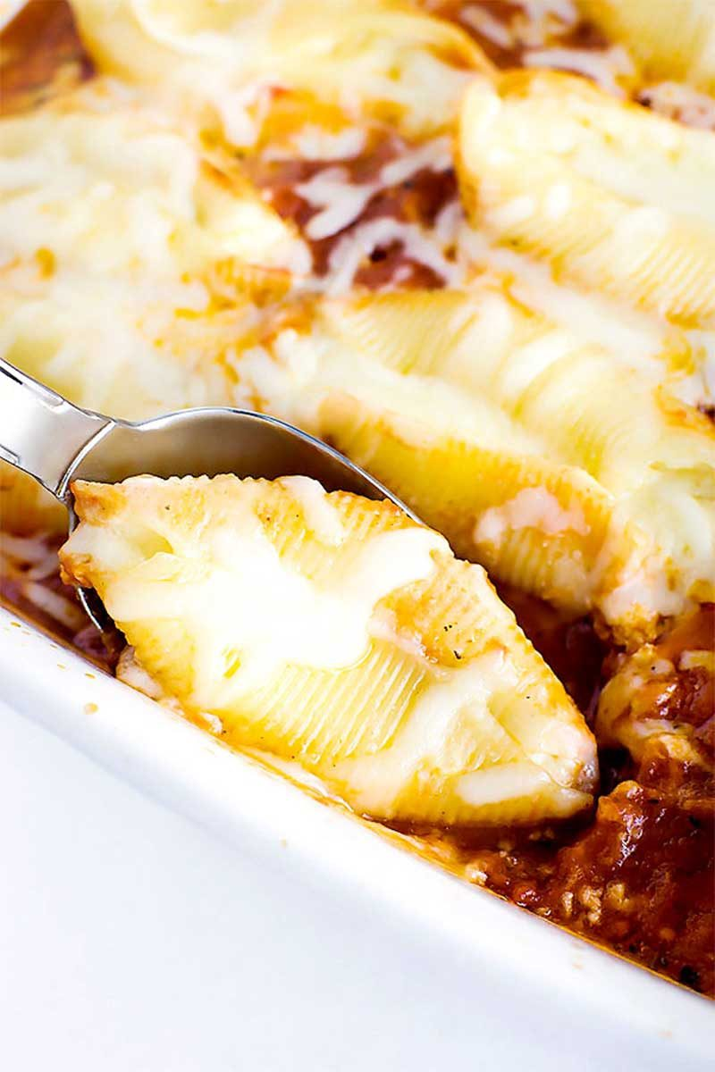 Ricotta Stuffed Shells! Jumbo shells stuffed with ricotta and mozzarella (plus and a filling of your choice!) then baked in a bed of homemade marinara sauce. | HomemadeHooplah.com