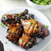 Sticky Honey Sriracha Drumsticks! Honey sriracha chicken that's baked so tender the meat falls off the bone. The sticky glaze is made with a perfect blend of tangy, spicy, and sweet. | HomemadeHooplah.com