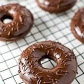 Chocolate Cake Donuts with Nutella Glaze! Baked and fluffy chocolate cake donuts that are coated with a rich Nutella glaze. A perfect treat for breakfast or dessert! | HomemadeHooplah.com