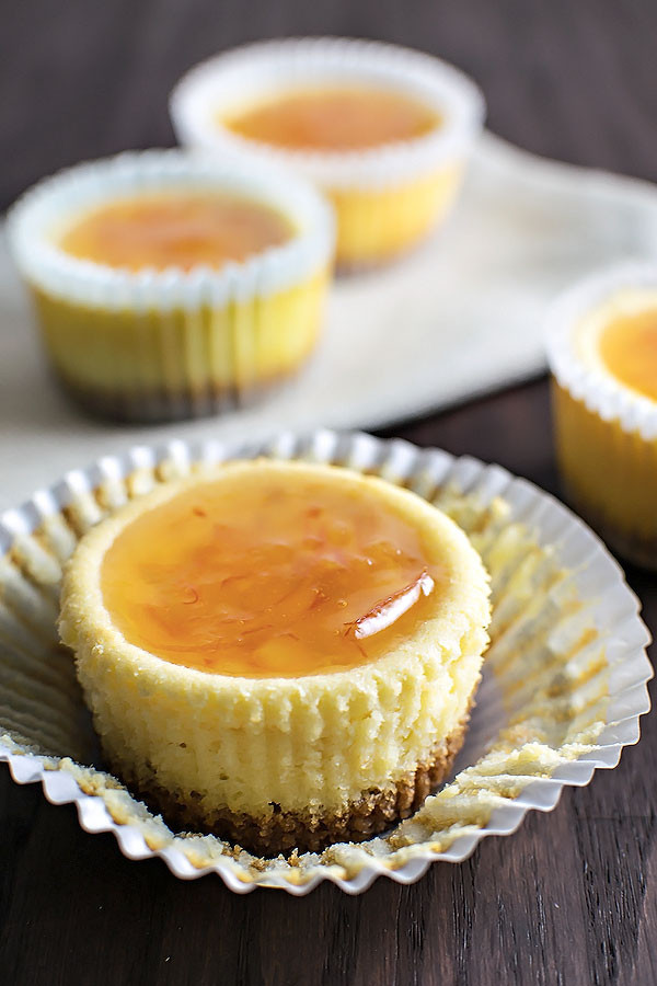 Orange Ricotta Cheesecake Cupcakes! If you own a muffin tin then you could have your own individual sized serving of orange cheesecake with a sweet orange marmalade glaze! | HomemadeHooplah.com