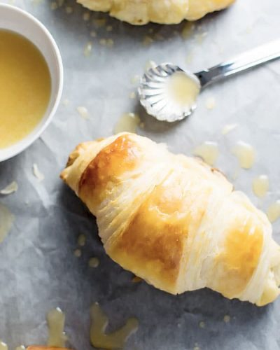 Homemade Croissants with Honey Butter Drizzle! With a little time, you can make your own flaky, buttery croissants This is a copycat recipe of the honey butter croissants from Cheddars! | HomemadeHooplah.com