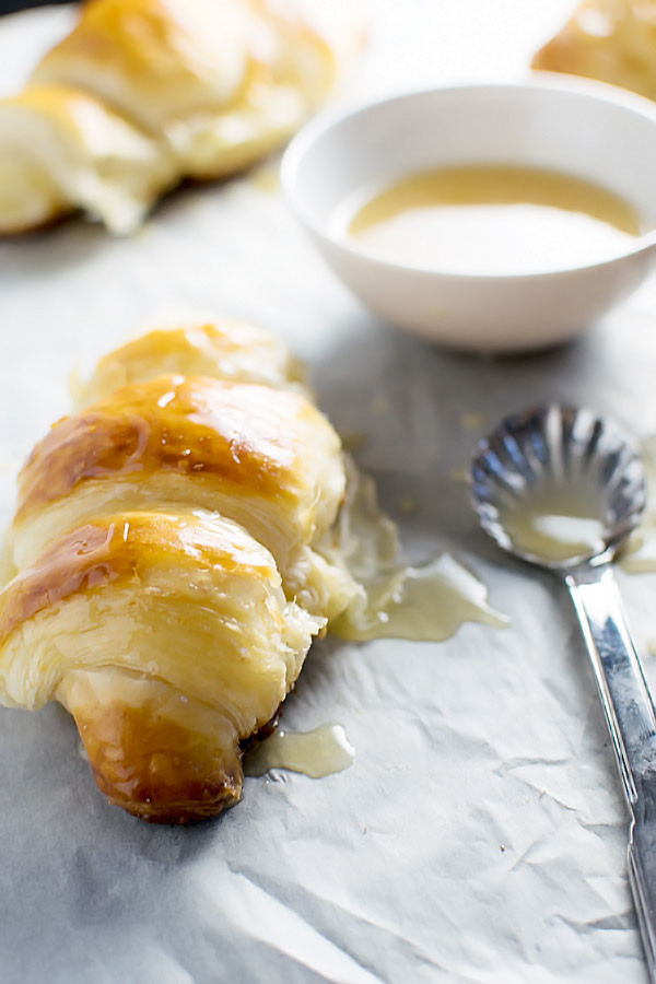 Homemade Croissants with Honey Butter Drizzle! With a little time, you can make your own flaky, buttery croissants This is a copycat recipe of the honey butter croissants from Cheddars!   HomemadeHooplah.com