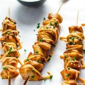 Teriyaki Chicken Kabobs with Sriracha Cream! These are the best chicken kabobs! Teriyaki chicken kabobs on the grill are marinated in teriyaki (only 5 ingredients!) and covered with sriracha cream.