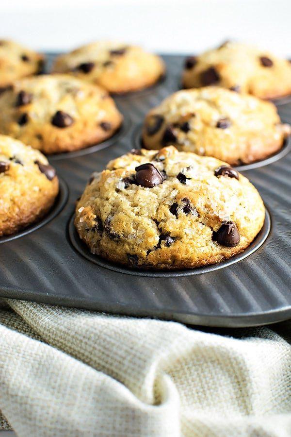 Chocolate Chip Muffins with Cinnamon and Nutmeg! Classic chocolate chip muffins, but with a twist - adding cinnamon and nutmeg to bring out a rich dark chocolate flavor. | HomemadeHooplah.com