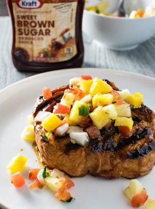 Grilled BBQ Pork Chops with Pineapple Salsa! Tender pork chops grilled with Kraft's Sweet Brown Sugar BBQ sauce and topped with pineapple salsa. #FireUpTheGrill #CollectiveBias | HomemadeHooplah.com
