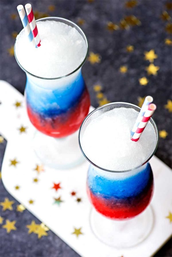 Red White and Blue Vodka Lemonade Slush! Celebrate your patriotism with a refreshing (and colorful!) slush made with grenadine, blue curacao, and spiked lemonade. | HomemadeHooplah.com
