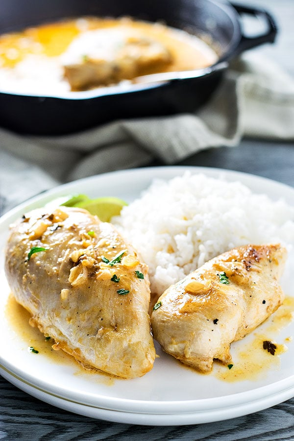 Creamy & Smoky Cilantro Lime Chicken! A one pan meal of tender chicken breasts cooked in a creamy sauce flavored with smoked paprika, lime, and cilantro. | HomemadeHooplah.com