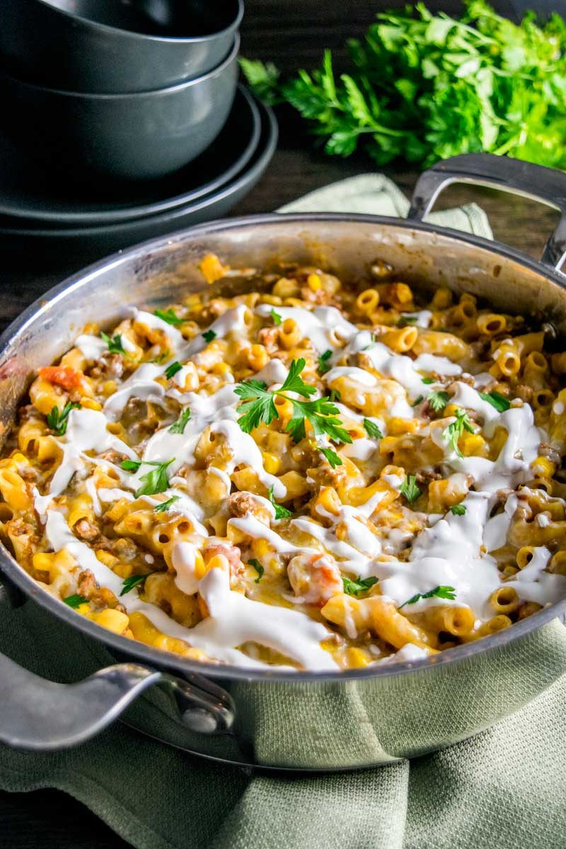One Pan Cheesy Taco Skillet! An easy taco skillet that's like a gourmet version of Hamburger Helper. Perfect for busy weeknights. And you can make it as spicy (or not) as you want!   HomemadeHooplah.com