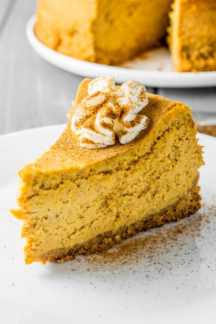 Classic Pumpkin Spice Cheesecake! Classic cheesecake infused with creamy pumpkin, plus a double dose of pumpkin spice - it's baked both in the cheesecake and in the crust! | HomemadeHooplah.com