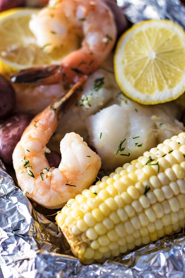 Garlic and Dill Seafood Bake - A restaurant-quality seafood bake made at home, right in your oven. Customize it with your favorite veggies or fish! | HomemadeHooplah.com