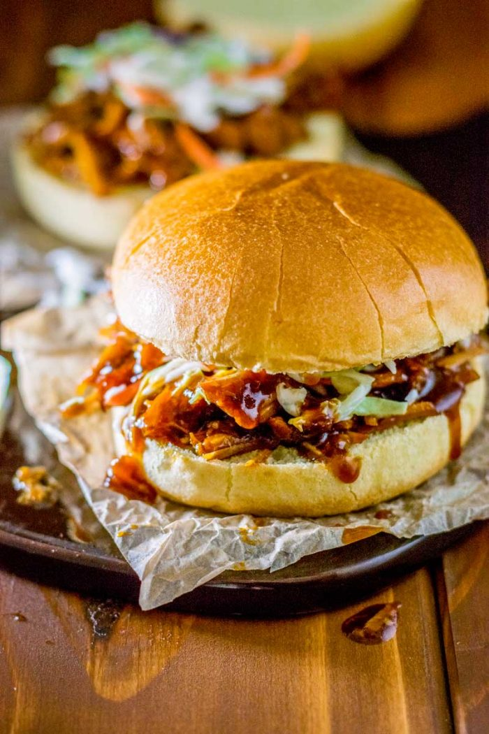 Sweet Crock Pot Pulled Pork! Transform your favorite BBQ sauce into deliciously sweet crock pot pulled pork that goes perfectly with just about any sandwich or taco topping. | HomemadeHooplah.com