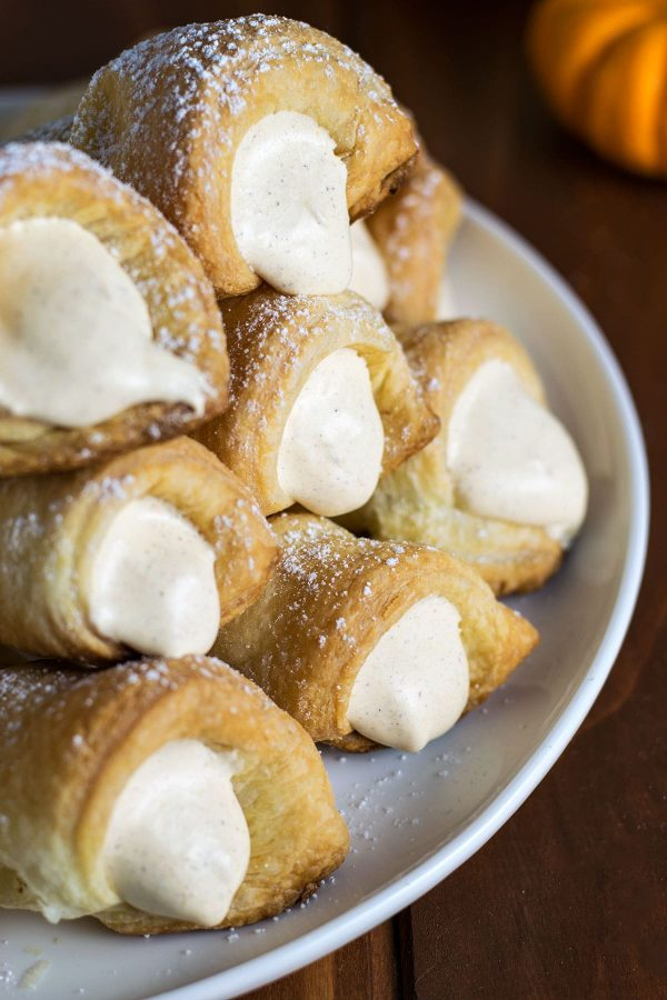 Pumpkin Spice Cream Horns! Delicate and flaky puff pastry with a creamy pumpkin spice cream horn filling. They are THE delicious embodiment of fall! | HomemadeHooplah.com