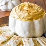 Pumpkin Cheesecake Dip! This easy and creamy pumpkin dip is the best way to cure a crowd's cravings for fall comfort food. Plus, there are white chocolate graham crackers for dipping! | HomemadeHooplah.com