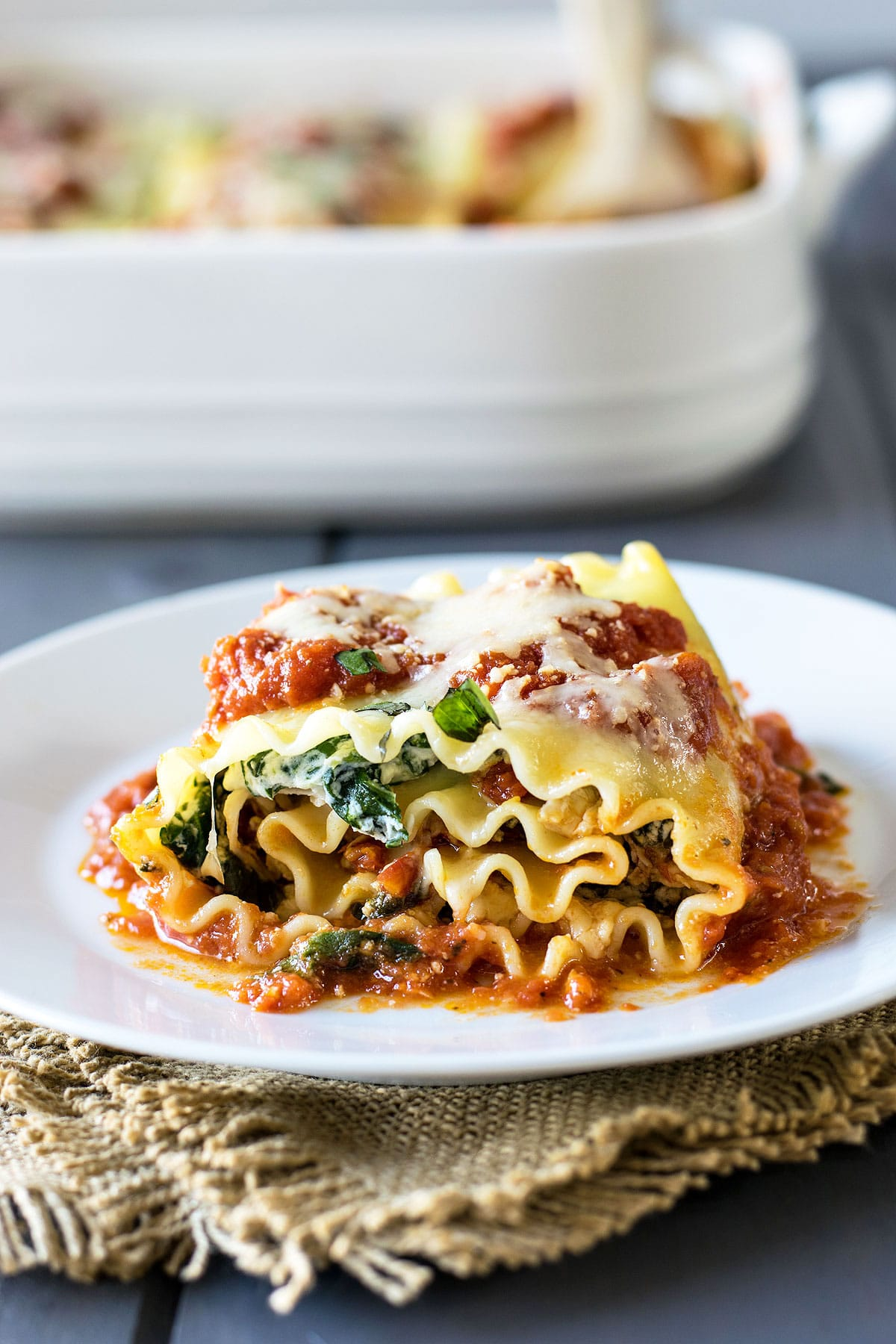 Chicken and Sun Dried Tomato Lasagna Roll-Ups! Take the delicious combo of chicken and sun dried tomatoes and wrap them up in a lasagna roll-up. Two great classics make a bold new flavor! | HomemadeHooplah.com