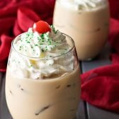 Chocolate Cream Pie Martini! If you love the cream pie, this drink is for you! A rich chocolate martini with whipped topping and just enough boozy burn to warm up your holiday.   HomemadeHooplah.com