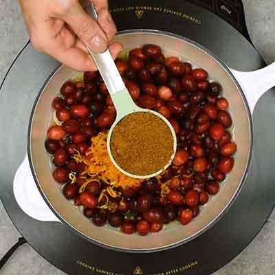 Cranberry Sauce Step 1- Add brown sugar.
