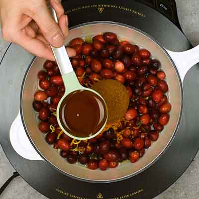 Cranberry Sauce Step 1- Add maple syrup.