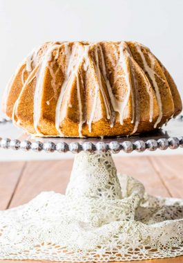 Eggnog Bundt Cake! Ultra moist and buttery eggnog bundt cake with hints of rum, cinnamon, and nutmeg, then coated with an eggnog glaze. It's the sweeter way to enjoy eggnog! | HomemadeHooplah.com