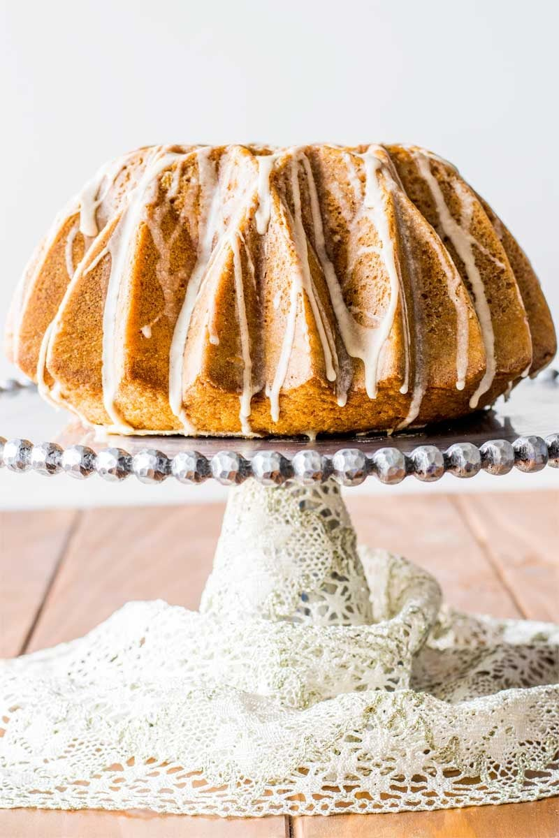 Eggnog Bundt Cake! Ultra moist and buttery eggnog bundt cake with hints of rum, cinnamon, and nutmeg, then coated with an eggnog glaze. It's the sweeter way to enjoy eggnog!   HomemadeHooplah.com