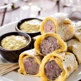Tortilla Wrapped Bratwursts with Beer Mustard! A unique and trendy appetizer that's the perfect finger food for all the meat lovers at your next party! | HomemadeHooplah.com #gotortillaland #partyfood #spon