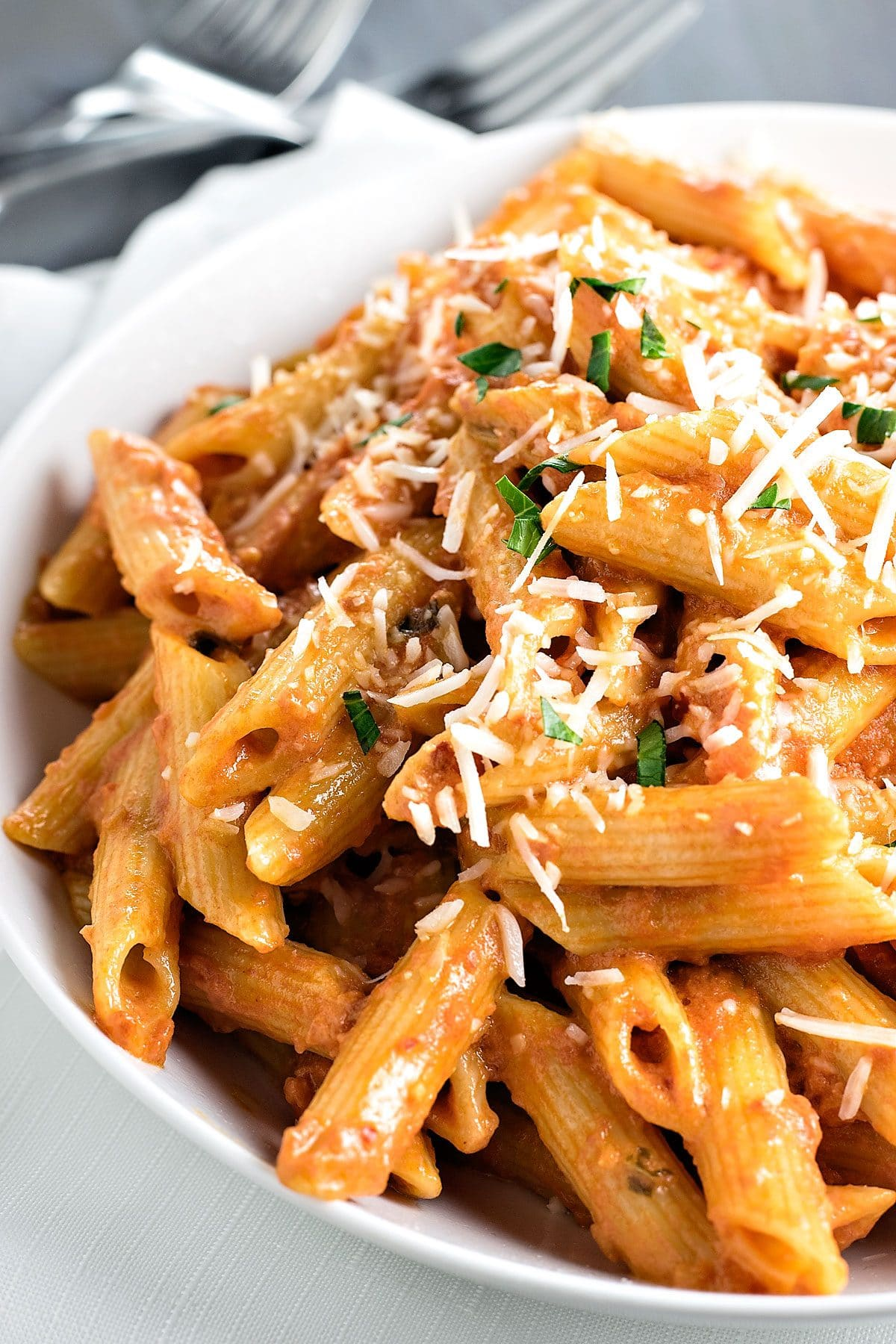 Penne Alla Vodka! Skip the restaurant and make the best penne alla vodka at home. This recipe has enough tomato to give the sauce a nice kick without overpowering the cream! | HomemadeHooplah.com