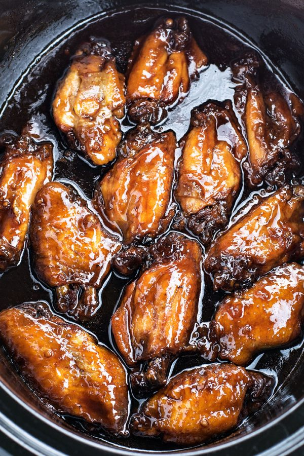 Crock Pot Sticky Chicken Wings! Chicken wings baked to tender perfection in an Asian-style BBQ sauce. | HomemadeHooplah.com