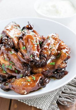 Crock Pot Sticky Chicken Wings! Sticky chicken wings cooked to tender perfection in a crock pot in an Asian-style BBQ sauce. Perfect for a weeknight dinner or a sports party! | HomemadeHooplah.com