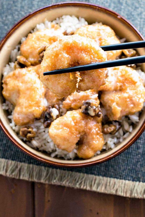 Honey Walnut Shrimp! Skip the takeout and make honey walnut shrimp at home. Light tempura, tender shrimp, candied walnuts, all covered in a sweetly tart sauce. | HomemadeHooplah.com