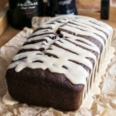 Baileys Dark Chocolate Guinness Bread! Rich and dark chocolate Guinness bread laced with chocolate chips and walnuts then frosted with a sweet Baileys glaze. | HomemadeHooplah.com