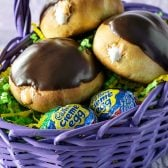 Cadbury Creme Stuffed Donuts! Everything you love about Cadbury Creme Eggs, but in donut form. Enjoy them year round with milk or dark chocolate glaze! | HomemadeHooplah.com