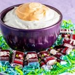Cadbury Creme Egg Dip! If you're a fan of Cadbury Creme Eggs then you'll love this dip! It's the best way to share creme eggs with everyone. Use your favorite holiday chocolate (or even cookies or pretzels) for dipping. | HomemadeHooplah.com