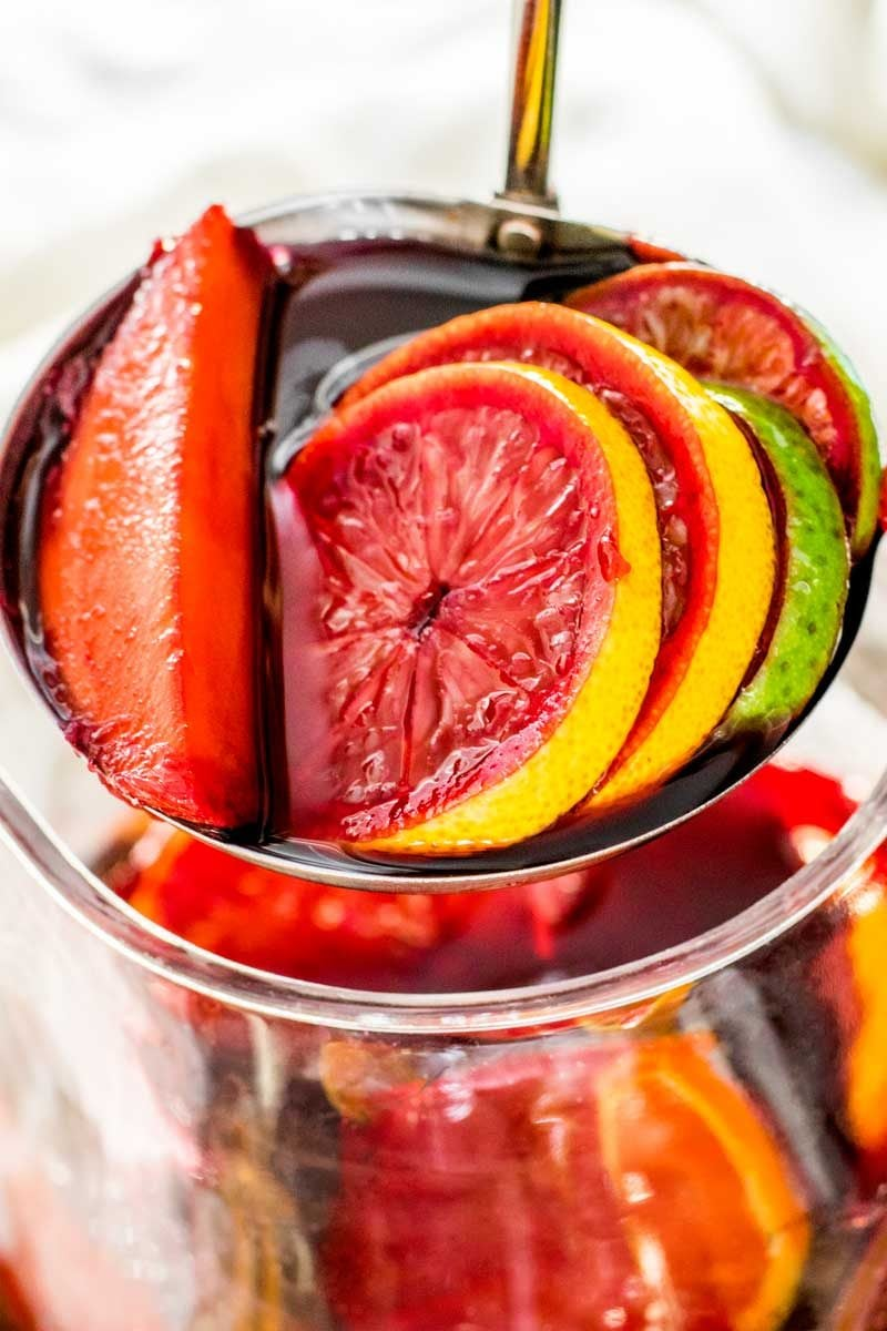 An easy red wine sangria recipe with mango, orange, lemon, and lime.