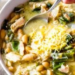White Chicken Chili! This white bean chicken chili is made with tender chicken, homemade chicken broth, roasted poblano chilis, and white cannellini beans. It's total comfort food! | HomemadeHooplah.com