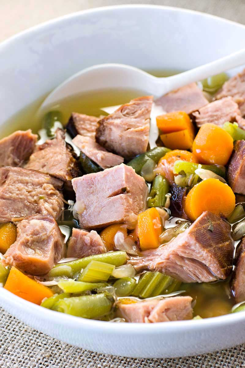 Crock Pot Ham and Vegetable Soup! Looking for a crock pot soup that still tastes gourmet? This ham and vegetable soup is an easy and flavorful dinner for any night of the week. | HomemadeHooplah.com