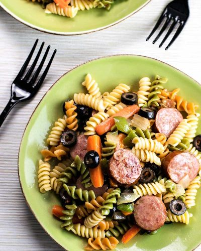 Smoked Sausage Pasta Salad! A simple and savory pasta salad made with Hillshire Farm smoked sausage, veggies, and tri-color pasta. Can be served hot or cold to fit any season! | HomemadeHooplah.com @KrogerCo #nohasslesavorymeal #Pmedia #ad