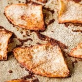 Cinnamon Sugar Tortilla Chips! These baked cinnamon tortilla chips are easy to make and perfect for dipping in all sorts of sweet desserts and frostings. Plus, they're a great and creative way to use up extra tortillas. | HomemadeHooplah.com