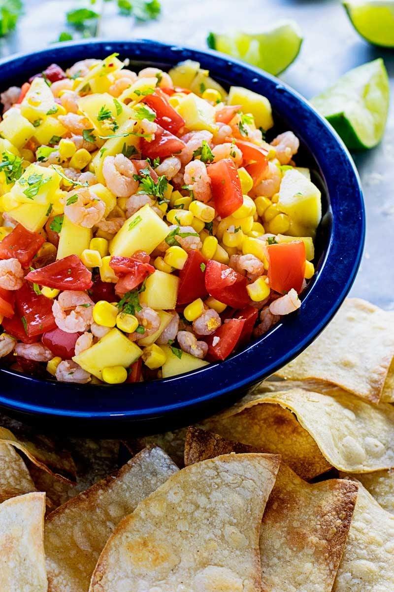 Mango Shrimp Salsa! A refreshing mango & shrimp salsa that's spiked adobe sauce for a little extra kick. Works perfectly as a party dip or wrapped in tacos! | HomemadeHooplah.com