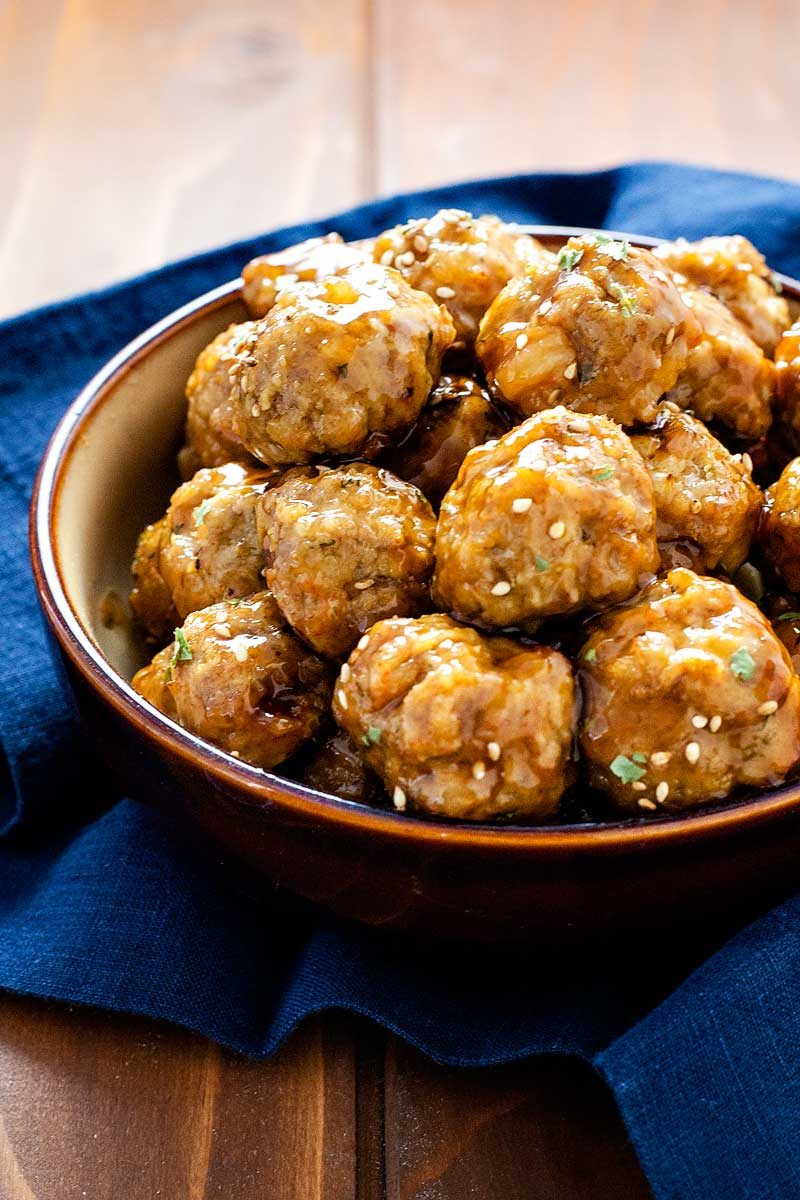 Pork and Shrimp Meatballs with Teriyaki Glaze! Savory pork and succulent shrimp meatballs tossed in a sweet teriyaki glaze. Perfect for parties, snacking, or on a bed of soba noodles! | HomemadeHooplah.com
