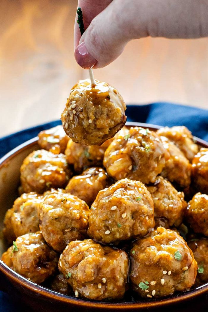 Pork and Shrimp Meatballs with Teriyaki Glaze! Savory pork and succulent shrimp meatballs tossed in a sweet teriyaki glaze. Perfect for parties, snacking, or on a bed of soba noodles!   HomemadeHooplah.com